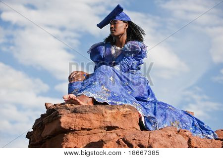 Herero African woman with traditional clothing, hairstyle and jewelry, Namibia, South Africa, and Botswana