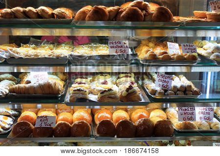 Various type of cakes in shop window in Italy