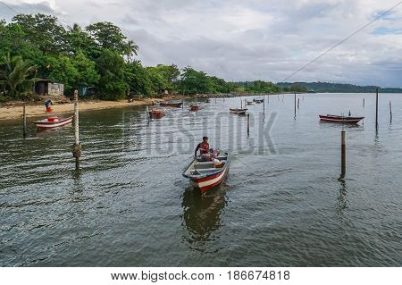 Labuan,Malaysia-May 10,2017:Morning scene of daily activities at Tanjung Aru village,fisherman with fishing boat ready to fishing in Labuan island,Malaysia.