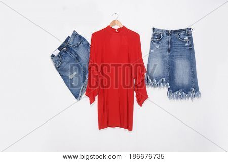 Blue two denim skirt with red sundress isolated