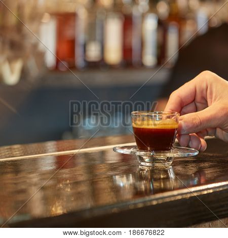 Hand holds cup of coffee
