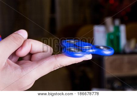 Close-up Of Teenager Spinning A Fidget Spinner On Finger