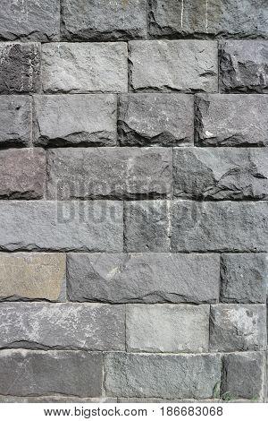 Rubble gray rectangular stone wall rubblework .