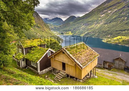 Cabins With Traditional Sod Roof In Geirangerfjord