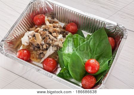 Healthy food, diet concept. Lunch box with Weight loss nutrition closeup. Mushrooms, spinach and tomatoes