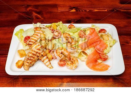 Salad Of Romaine Lettuce With Prawns, Smocked Salmon, Croutons, Grilled Chicken, Cherry Tomatoes Wit