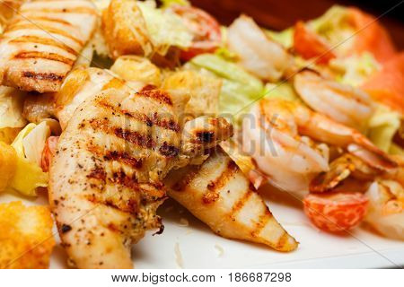 Close-up Of Salad Of Romaine Lettuce With Prawns, Smocked Salmon, Croutons, Grilled Chicken, Cherry