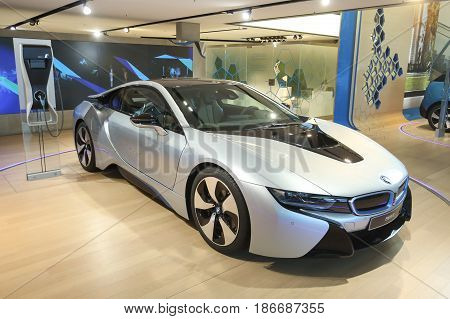 MUNICH GERMANY - MAY 6 2017 : Exhibited BMW i8 electric automobile in the BMW Welt exhibition center in Munich Germany.