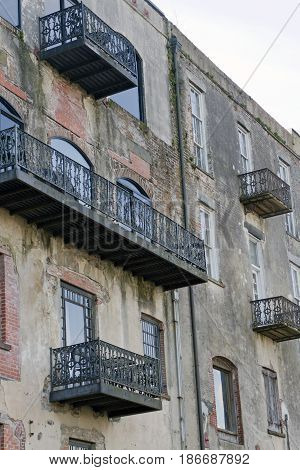 Savannah, Georgia, USA - January 20, 2017: Historical wrought iron balconies and architecture along River Street a popular tourist destination