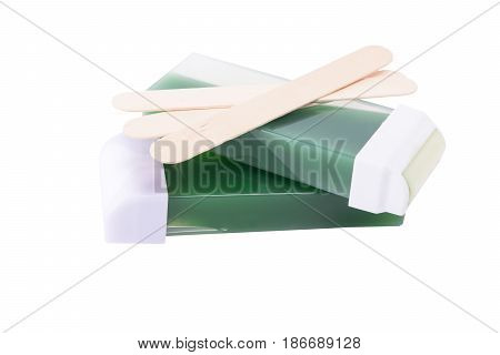 concept of the wax and wooden sticks for the hair isolated on white background