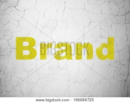Marketing concept: Yellow Brand on textured concrete wall background