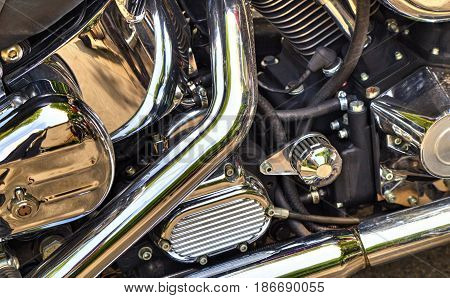 Shiny black motorcycle engine close up view