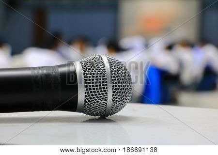 microphone wireless on the table in seminar conference room: Select focus with shallow depth of field.