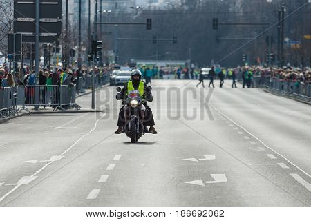 BERLIN - APRIL 03 2016: The annual Berlin Half Marathon. Before the start of the marathon. Safety motorcycle.