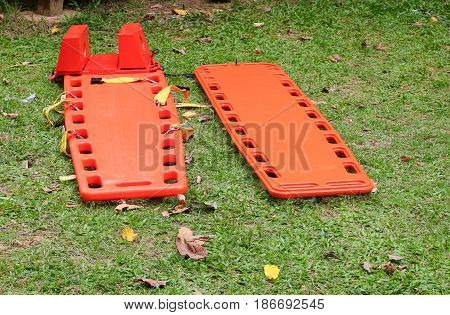 stretcher two for emergency paramedic service medical equipment on lawn background