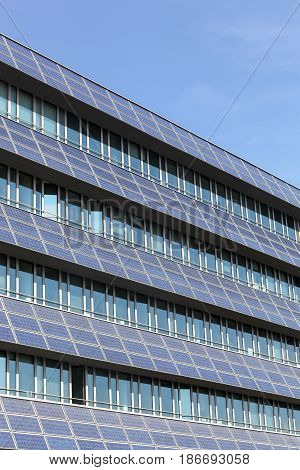 Solar panels on a wall of a building