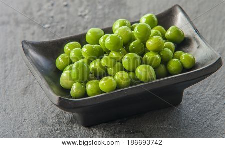 fresh Green peas close up on wooden background