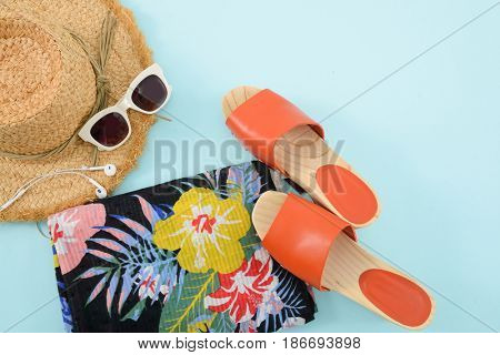 Fashion. Summer woman accessories-Summer floral scarf, shoes,hat,sunglasses on blue background