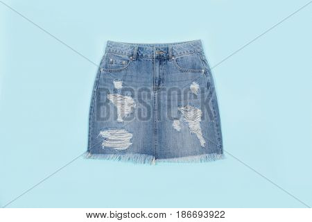 Blue denim skirt isolated on blue background
