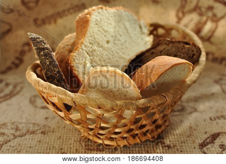 Assorted Sliced Bread In A Wicker Basket.