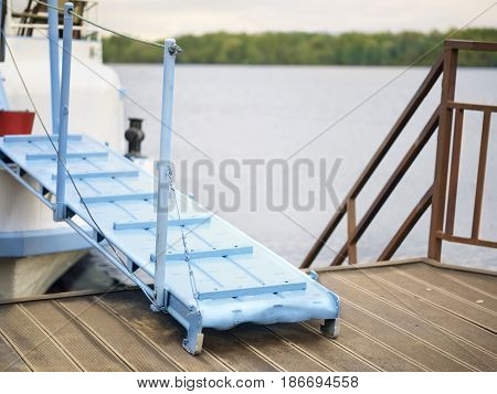 A marina with ship and gangplank outdoor shot concept of travel by water