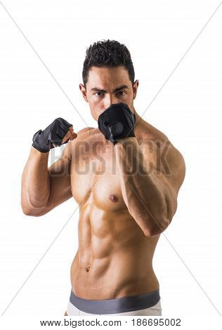 Half Body Shot of a Topless Muscled Man Wearing Black Gloves for Workout Isolated on White Background.