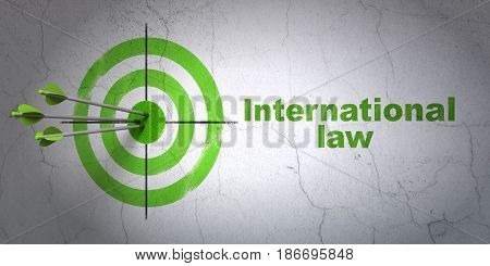 Success politics concept: arrows hitting the center of target, Green International Law on wall background, 3D rendering