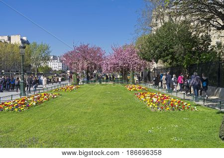 PARIS FRANCE - APRIL 2 2017: April in Paris. Square at the Cathedral of Notre Dame on a sunny day.