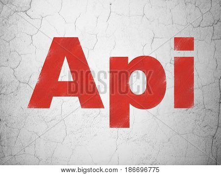 Programming concept: Red Api on textured concrete wall background