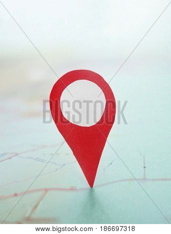 Red locator symbol on a map background