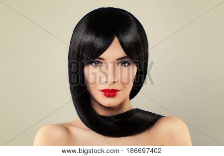 Cute Brunette Woman with Long Black Silky Hair and Makeup on Background. Barber Shop or Beauty Salon Background