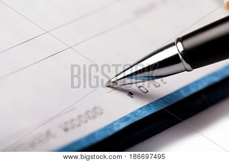 Chequebook pen bank check paying check check payment blank check finance
