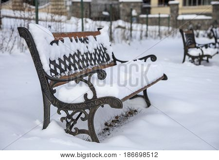 Bench of love with snow in Sofia Bulgaria