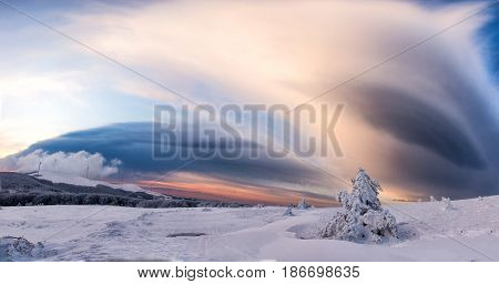 Beautiful winter landscape with frozen lake crack and sunset sky. Composition of nature.