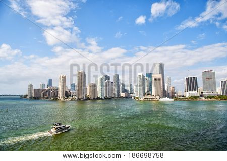 Miami Skyscrapers With Blue Cloudy Sky, Boat Sail, Aerial View