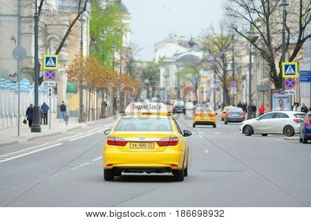 Moscow, Russia - May, 7, 2017: Taxi drives in a center of Moscow