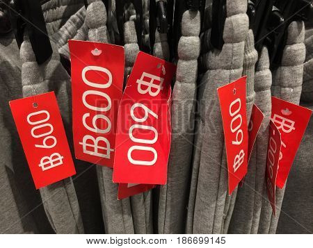 Colorful clothes hanging on a hanger and price tag with Thai baht