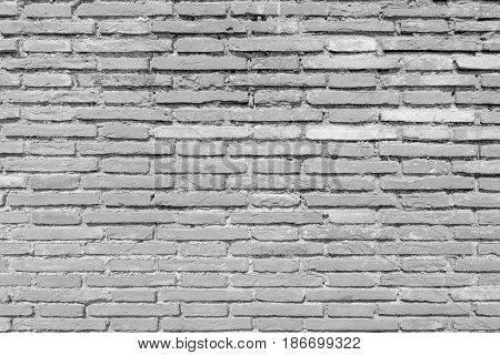 aged grunge white brick wall texture as background.
