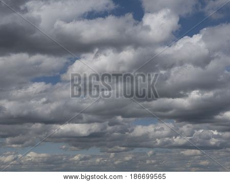 Dramatic clouds in the sky. Cloudy skies with misty haze, meteorological forecast.