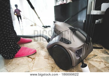 Mom floor vacuum cleaner chores mother point of view
