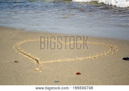Heart on beach. Romantic composition. Foto beach