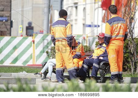 Moscow, Russia - May, 7, 2017: Municipal workers have a rest on Moscow street