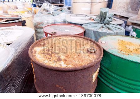 Toxic chemical waste dumped in rusty barrels