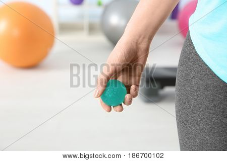 Woman with stress ball in clinic, closeup