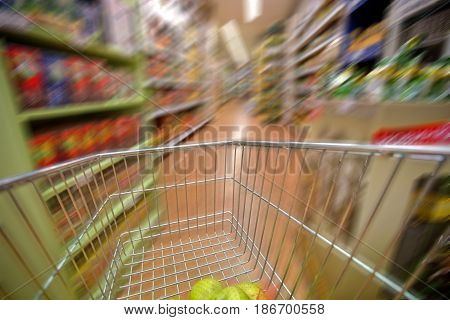 Supermarket shopping cart retail groceries aisle speed blurred motion