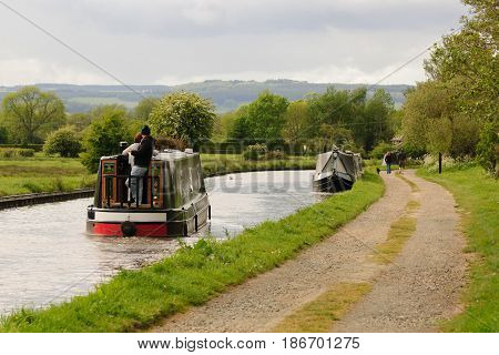 Shropshire UK - May 14 2017: Traditional British narrowboats navigating down the Shropshire Union canal in England UK