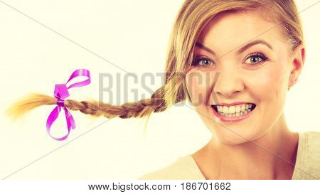 Face expression happiness concept. Teenage girl in blonde braid windblown hair making happy cheerful faces.