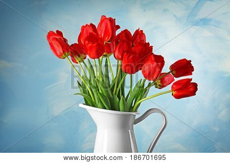 Vase with beautiful flowers on color background