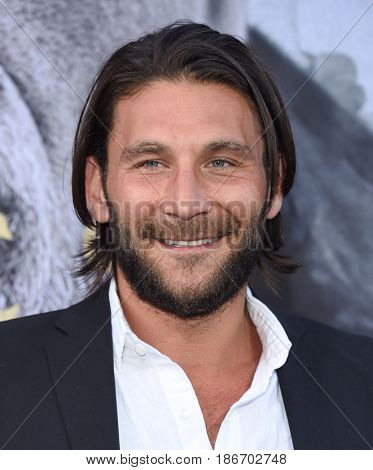 "LOS ANGELES - MAY 08:  Zach McGowan arrives for the 'King Arthur: Legend Of The Sword"" World Premiere on May 8, 2017 in Hollywood, CA"