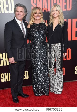 LOS ANGELES - MAY 10:  Kurt Russell, Goldie Hawn and Kate Hudson arrives for the 'Snatched' World Premiere on May 10, 2017 in Westwood, CA